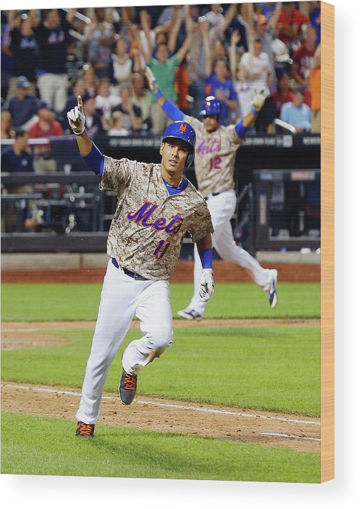 Scoring Wood Print featuring the photograph Juan Lagares and Ruben Tejada by Jim Mcisaac