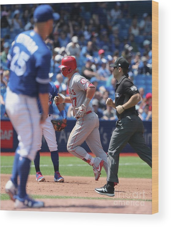 People Wood Print featuring the photograph Mike Trout and Marco Estrada by Tom Szczerbowski