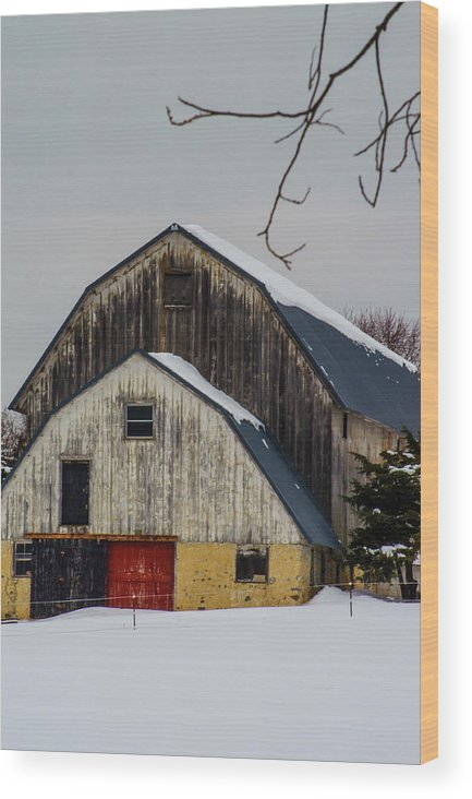 Weathered Barn With Red Door In Snow Wood Print featuring the photograph The Barn With A Red Door by Deborah Smolinske