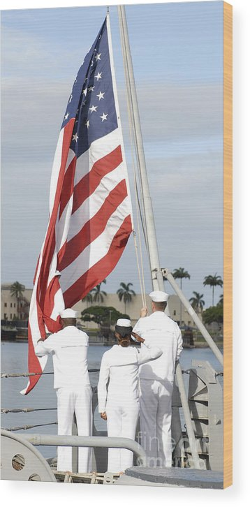 Pearl Harbor Wood Print featuring the photograph Sailors Hoist The American Flag by Stocktrek Images