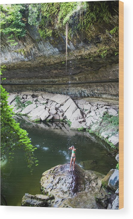 High Angle View Wood Print featuring the photograph A Young Woman Enjoys The Hamilton Pool by Michael Hanson