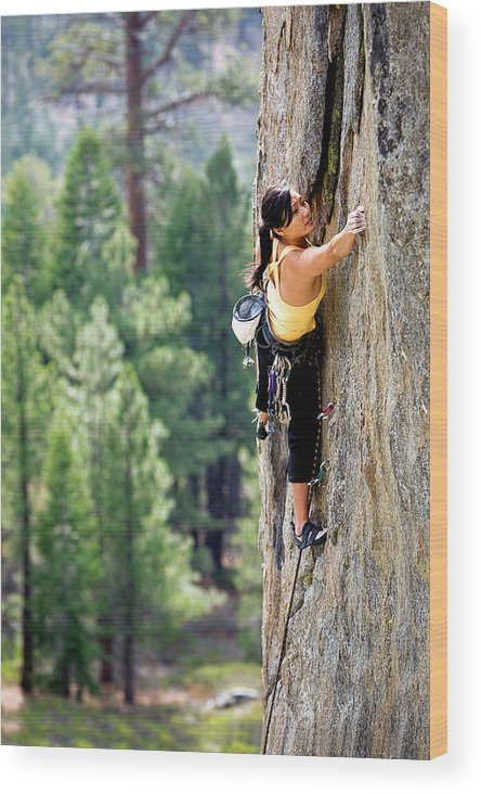 Action Wood Print featuring the photograph Attractive Woman Rock Climbing High by Corey Rich