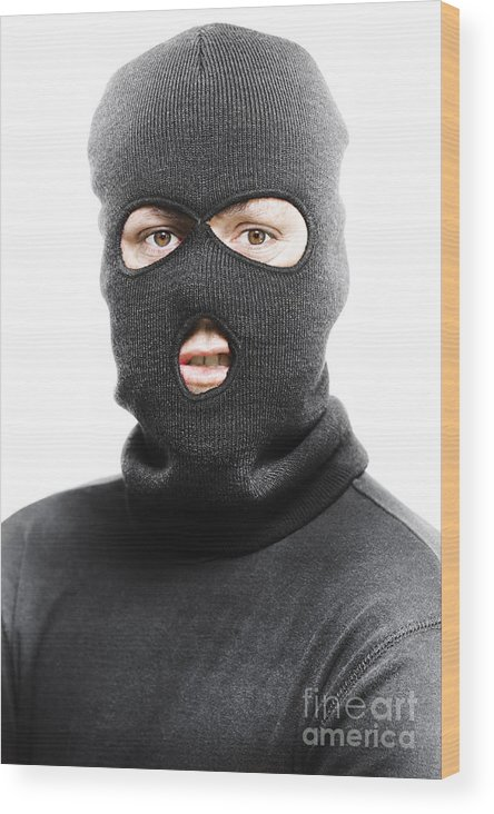 Background Wood Print featuring the photograph Face Of A Burglar Wearing A Ski Mask Or Balaclava by Jorgo Photography - Wall Art Gallery