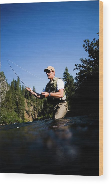 Action Wood Print featuring the photograph A Fly-fisherman In The Truckee River by Jay Reilly