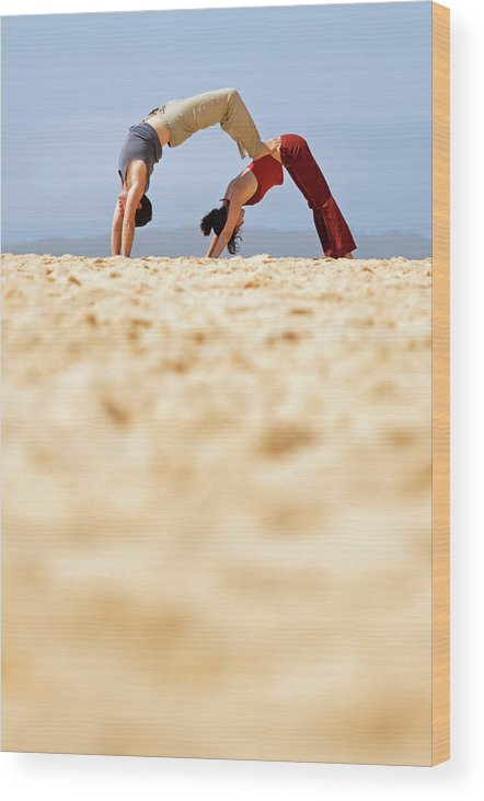Australia Wood Print featuring the photograph A Man And Woman Practicing Yoga by Lars Schneider