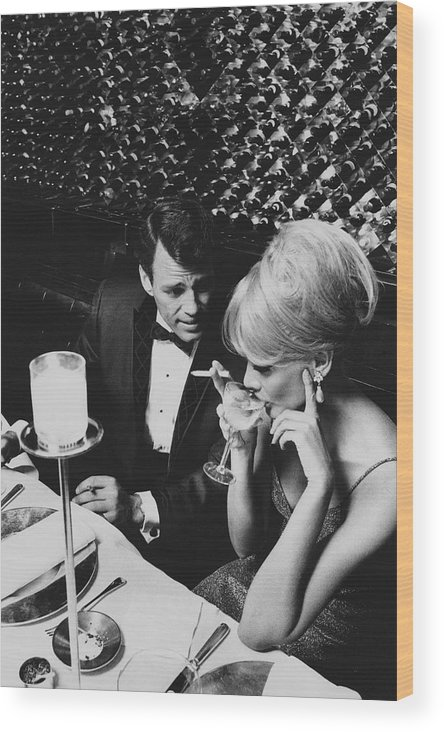 Architecture Wood Print featuring the photograph A Glamorous 1960s Couple Dining by Horn & Griner