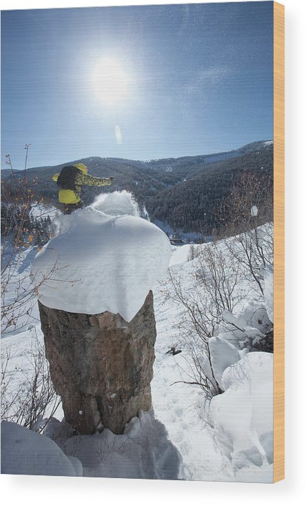 Arms Raised Wood Print featuring the photograph A Snowboarder Jumps Off A Cliff by Patrick Orton