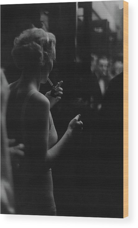 Personality Wood Print featuring the photograph A Woman Smoking At The Music Box by Remie Lohse