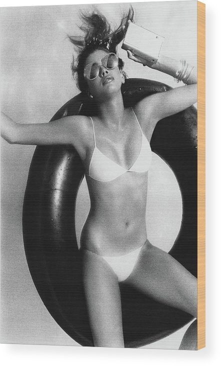 Accessories Wood Print featuring the photograph Debbie Dickinson Floating On An Inner Tube by Albert Watson