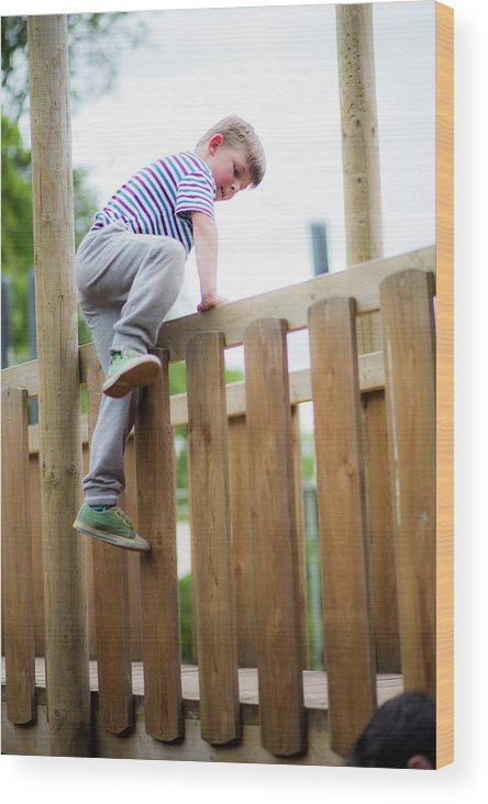 Photography Wood Print featuring the photograph Boy Climbing Over Wooden Fence by Samuel Ashfield