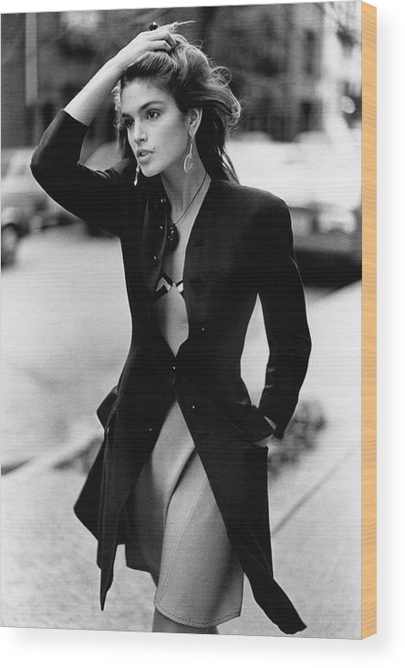 Accessories Wood Print featuring the photograph Cindy Crawford Wearing A Wool Coat Over A Slip by Arthur Elgort