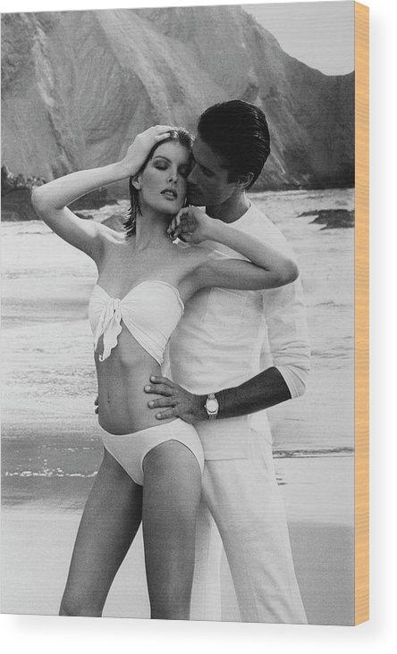 Beauty Wood Print featuring the photograph Rene Russo Posing With A Male Model On A Beach by Francesco Scavullo