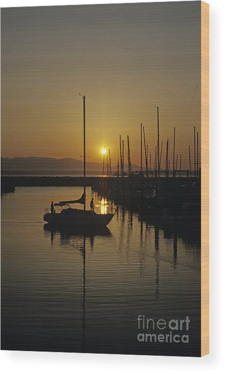 Landscape Wood Print featuring the photograph Silhouetted Man On Sailboat by Jim Corwin
