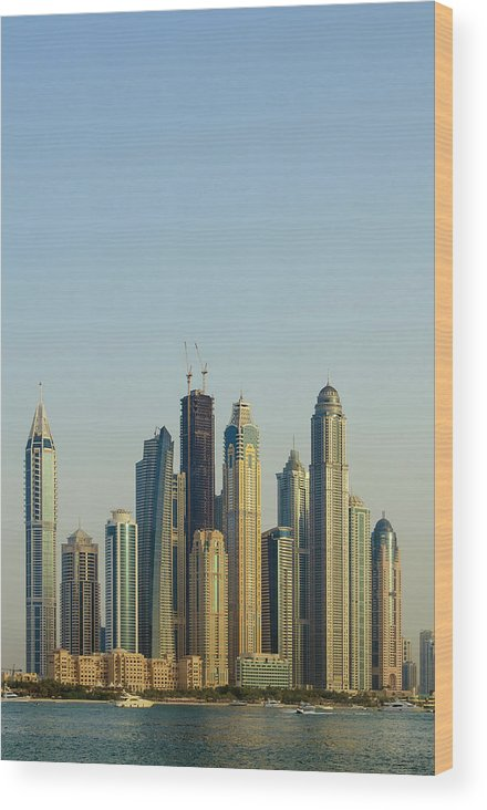 City Wood Print featuring the photograph Skyline Of Buildings Around The Dubai by Michael Defreitas