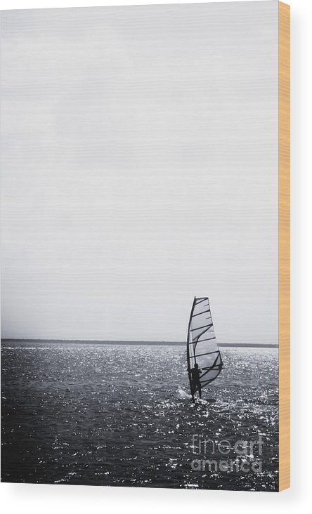 Sea; Ocean; Water; Lake; Wind; Surfer; Alone; Vast; Expanse; Transport; Transportation; Sport; Relax; Relaxation; Vacation; Tourism; Tourist; Recreation; Silhouette Wood Print featuring the photograph Wind Surfing by Margie Hurwich