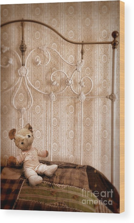 Bed Wood Print featuring the photograph Worn Teddy Bear On Brass Bed by Jill Battaglia