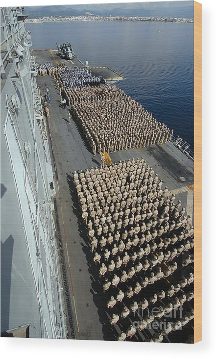 Color Image Wood Print featuring the photograph Crew Aboard The Amphibious Assault Ship by Stocktrek Images