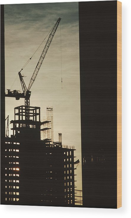 Construction Wood Print featuring the photograph Silhouette Crane At A Skyscraper by Ira Block