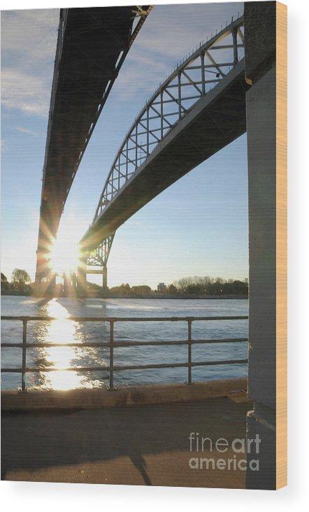 Sunrise Wood Print featuring the photograph Sunrise Blue Water Bridges by Ronald Grogan