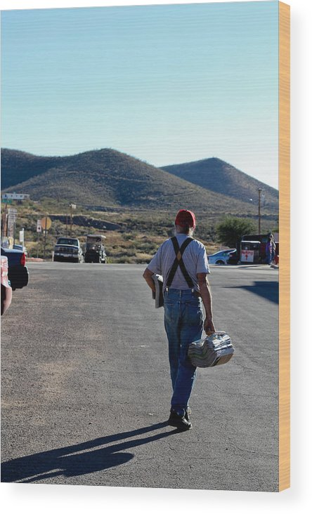 Arizona Wood Print featuring the photograph Man Walking With Newspapers by Maxime Ordureau
