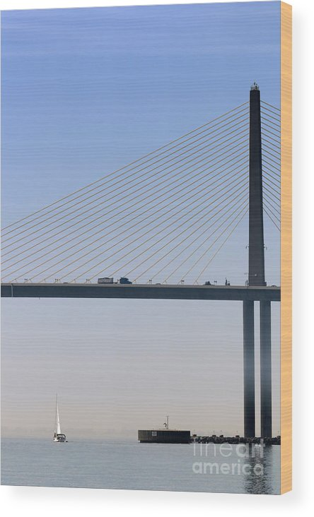 Sailing Wood Print featuring the photograph A Sailing Boat Passes Under The Bridge In Tampa Bay by Louise Heusinkveld
