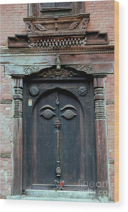 Nepal Wood Print featuring the photograph Buddha's Eyes On Nepalese Wooden Door by Anna Lisa Yoder