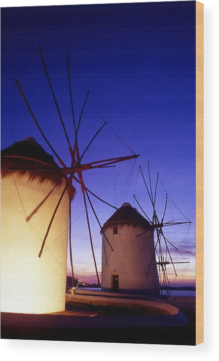 Architecture; Architectural; Cyclades; Mykonos Wood Print featuring the photograph Greece. Mykonos Town. Illuminated Windmills At Dusk. by Steve Outram