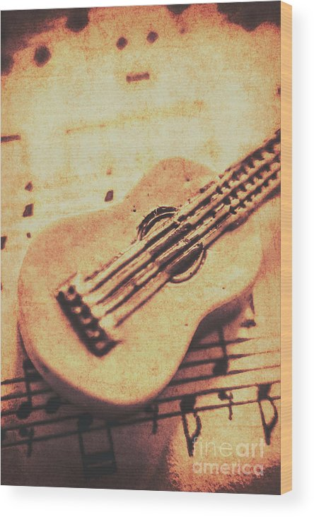 Folk Wood Print featuring the photograph Little Carved Guitar On Sheet Music by Jorgo Photography - Wall Art Gallery