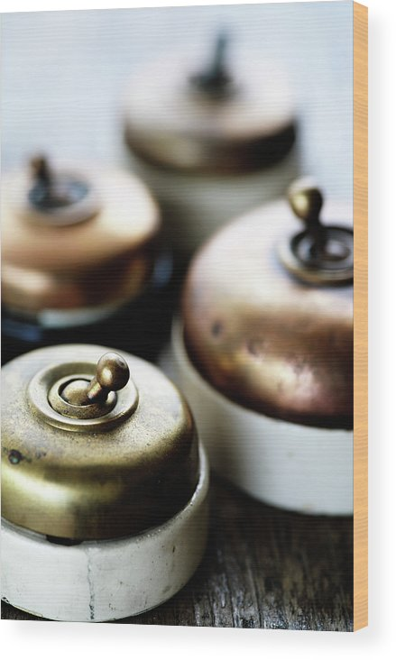 Light Wood Print featuring the photograph Old Light Switches by Neil Overy