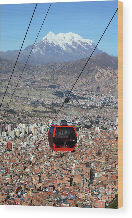 Bolivia Wood Print featuring the photograph Red Line Cable Car Cabin And Mt Illimani Bolivia by James Brunker