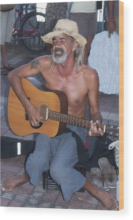 Guitar Wood Print featuring the photograph Strumming A Tune In Key West by Carl Purcell