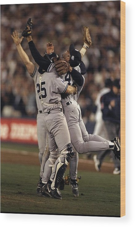 Following Wood Print featuring the photograph 1998 World Series 1998 by Al Bello