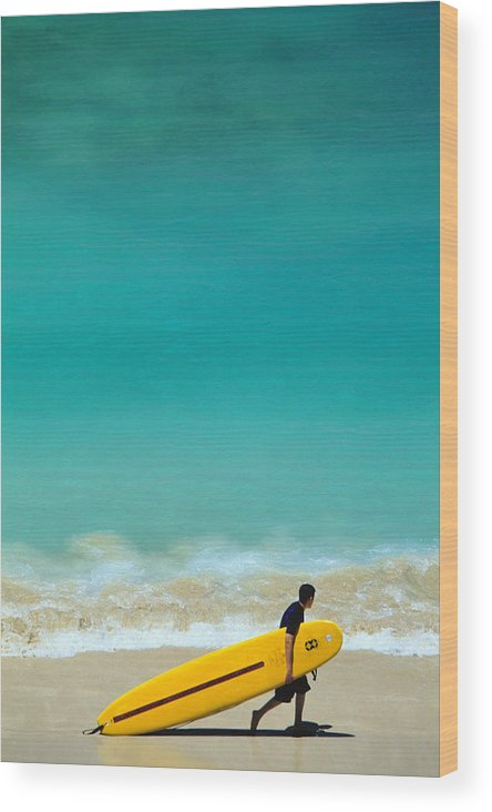 Water's Edge Wood Print featuring the photograph Boy With Yellow Surfboard At Waikiki by Ann Cecil