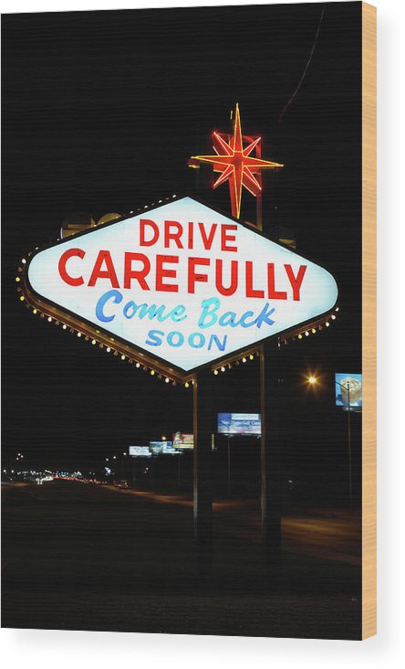 Downtown District Wood Print featuring the photograph Drive Carefully, Come Back Soon Sign by Jupiterimages
