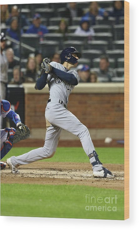 American League Baseball Wood Print featuring the photograph Christian Yelich by Mike Stobe