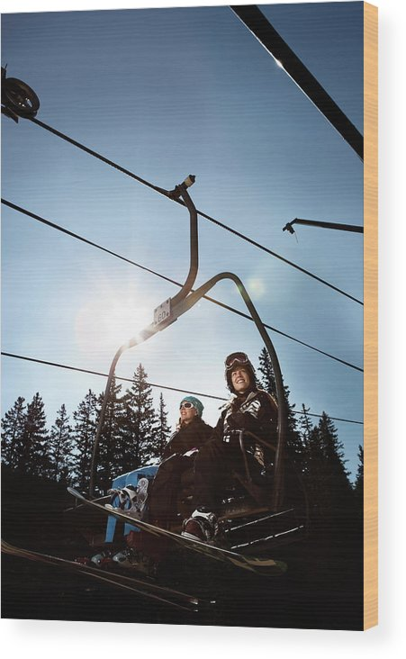 20s Wood Print featuring the photograph A Skier And Snowboarder Share The Chair by Ryan Heffernan
