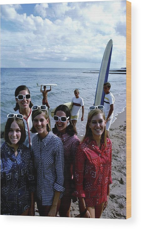 Fashion Wood Print featuring the photograph Models And Surfers On A Beach by William Connors