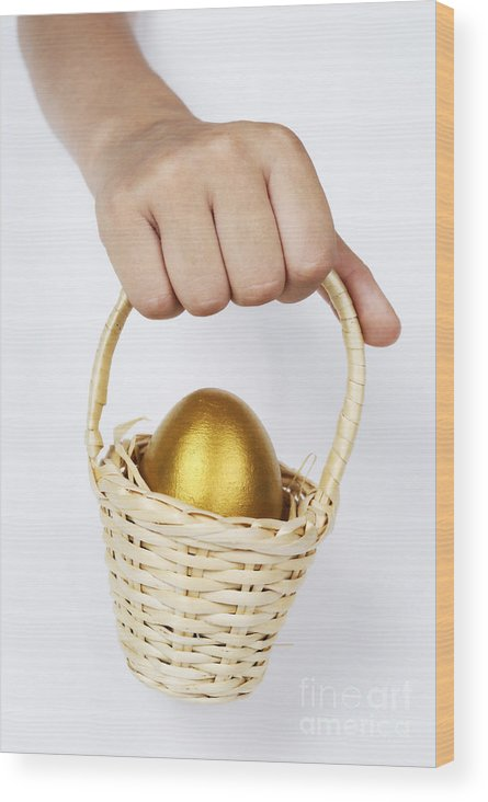 Food And Drink Wood Print featuring the photograph Girl's Hand Holding Basket With Golden Egg by Sami Sarkis