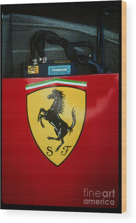 The Prancing Horse Of Ferrari On Nigel Mansells Racer. Wood Print featuring the photograph Ferrari F1 Sidepod Emblem by Paolo Govoni