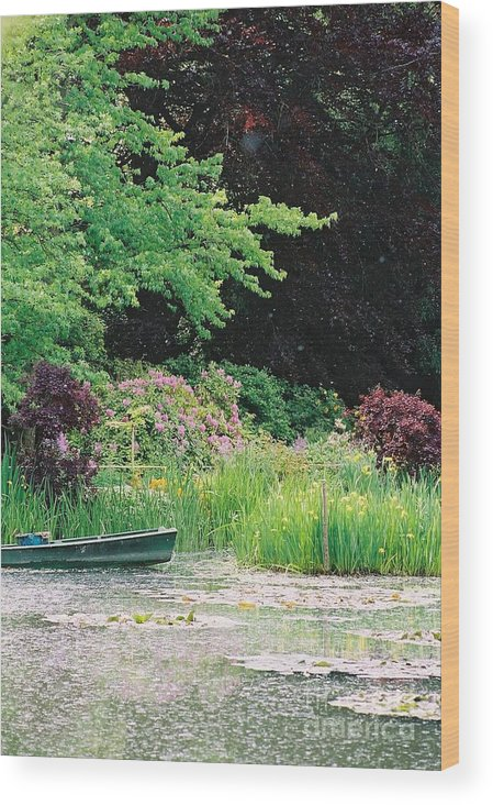 Monet Wood Print featuring the photograph Monet's Garden Pond And Boat by Nadine Rippelmeyer