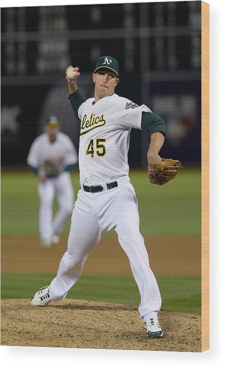 Ninth Inning Wood Print featuring the photograph Cleveland Indians V Oakland Athletics - 1 by Thearon W. Henderson