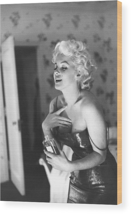 People Wood Print featuring the photograph Marilyn Monroe With Chanel No. 5 by Michael Ochs Archives