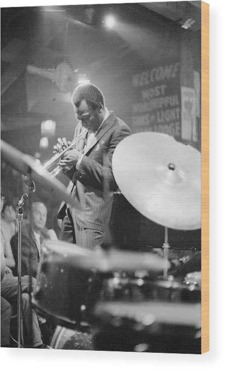 Concert Wood Print featuring the photograph Miles Davis Performing In Nightclub by Bettmann