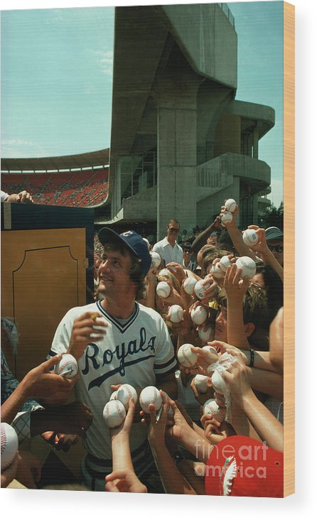 Crowd Wood Print featuring the photograph Young Fans Hold Up Baseballs For Royals Star George Brett To Sign by Ted Spiegel