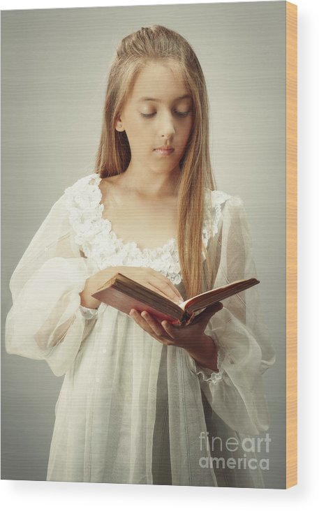Young Wood Print featuring the photograph Young Girl Reading A Book by Amanda Elwell