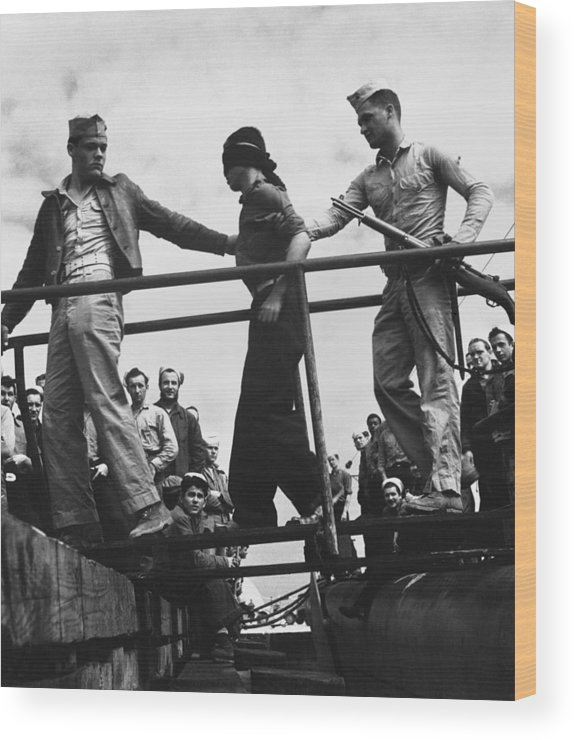 History Wood Print featuring the photograph U.s. Marines Unloading A Japanese Pow by Everett