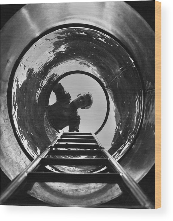 History Wood Print featuring the photograph U.s. Sailor Looks Down The Hatch by Everett