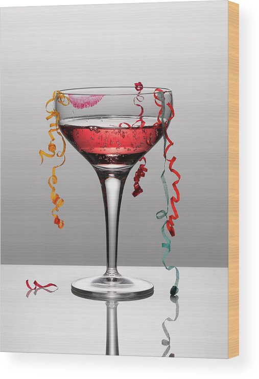 Streamer Wood Print featuring the photograph Confetti Hanging From Glass Of Pink by Andy Roberts