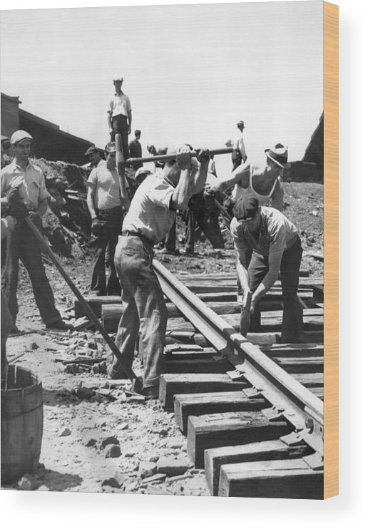 1035-1026 Wood Print featuring the photograph Men Laying Railroad Track by Underwood Archives