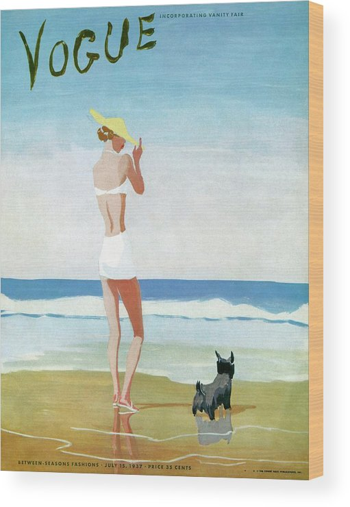 Animal Wood Print featuring the photograph Vogue Magazine Cover Featuring A Woman On A Beach by Eduardo Garcia Benito